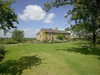 Wonderful views over the Cotswolds, heated pool, tennis court and games room