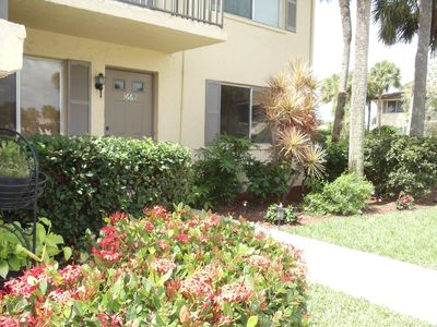 Attractively landscaped entranceway of this lovely 1st floor and end unit condo