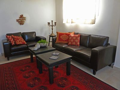 Feel the Jerusalem atmosphere in relaxing   living room .