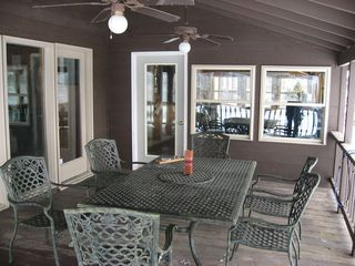 Linwood lodge photo - Relax and enjoy the activities, or dine out on the covered deck.