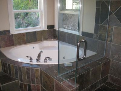 Master bath with jetted tub and separate glass shower