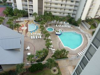 Mainsail Resort condo photo - South pool, hot tub, and enclosed kiddy pool v