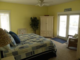 Oak Island house photo - Master bedroom to porch w/ private bath, garden tub sep/shower