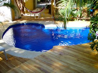 Tamarindo studio photo - The pool is just steps away, stays cool and has sofa style seating.