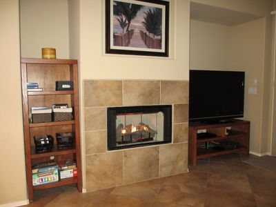 Family room with gas fireplace, big screen TV, DVD library and games