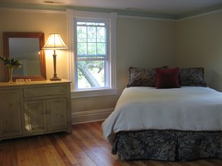 Wytheville farmhouse photo - Windows on three sides, this upstairs bedroom has plenty of fresh country air.