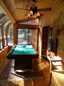 Sunroom has a 3/4 pool table, electronic darts, even an electric boot dryer!