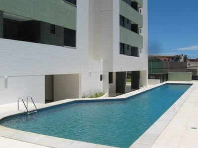 Modern fully-furnished apartment with swimming pool, gym and game room.