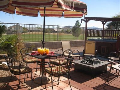 Back patio, fire pit , hot tub, golf course