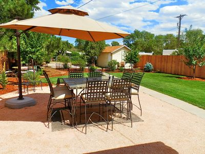 Huge backyard w/ tons of outdoor seating and room for the kids or dogs to play
