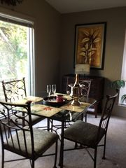 Langley house photo - Casual dining area overlooking lake