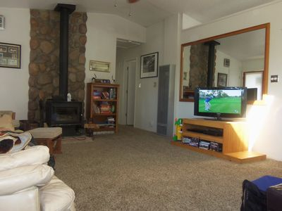 Large living area with wood stove, flat screen TV and lot's of movies.