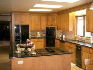 Boone estate photo - Kitchen .. granite counters & Jennaire cooktop