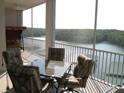 Screened in porch overlooking the lake and protected MO conservation land.