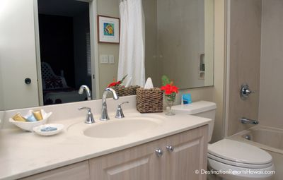 Right off the twin bedroom is this up-to-date bathroom with a tub shower combo.