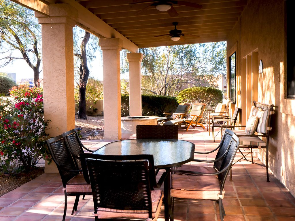 large covered patio with  fans ideal for outdoor dining, seating and lounging
