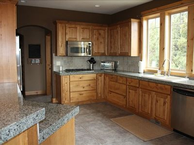 large kitchen-fully stocked, ss appliances, double ovens!