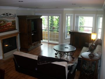 Entertain at the bay window bar or get cozy with a real fireplace~