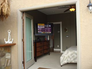 Henderson house photo - Lounge in the pool and watch Directv in HD on this 40'' LCD w/portable speakers