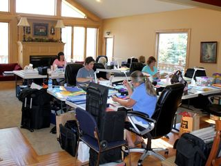 Amery house photo - Everyone working on their own scrapbooking project