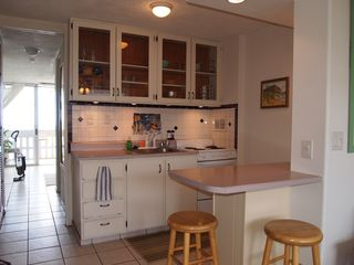 Makaha condo photo - kitchen is fully equipped with flatware, dishes, glasses, coffee maker, etc...