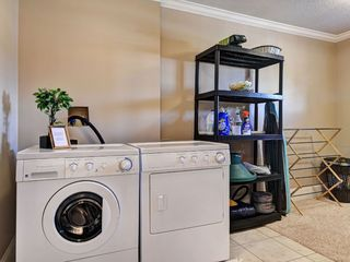 Victoria townhome photo - Fully equipped laundry room with washer, dryer, iron, ironing board and dry rack