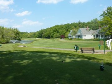 13th tee and view of pond with fountain