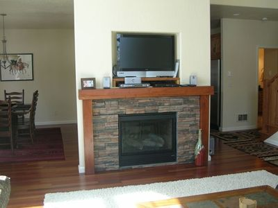 Living Room with Two Sided Fire Place. Plasma TV.