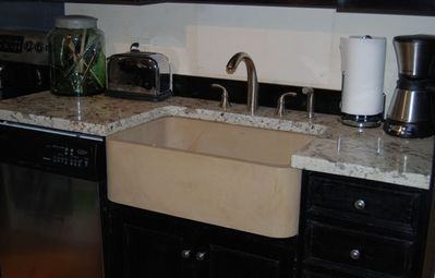 granite countertops with stone farm sink