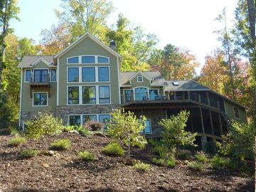 Lake Jocassee house rental - Rear elevation of home. Main & lower decks to right. Master balcony on left