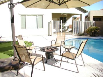 Tolleson house rental - Pool side entertaining area with firepit