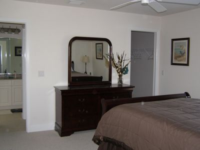 master bedroom with queen bed, dresser, closet and en-suite bathroom