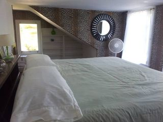 Northport estate photo - Third floor leopard room! Comfy tempurpedic king bed.