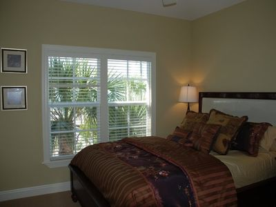 Queen Guest Room with ocean views thru the palm trees!