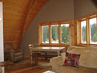 West Yellowstone house photo - Far end of upstairs family room w/ leather recliner, table for games, big views!
