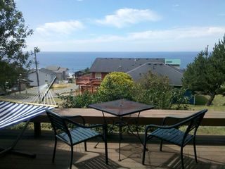 Lincoln City cottage photo - Enjoy the view from the deck. Hammock available in nice weather.