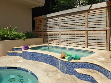 Inviting hot tub next to pool