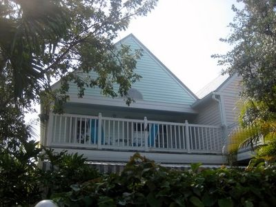 Key West condo rental - You can lounge on the balcony. Oversee lush gardens and peek at the ocean.