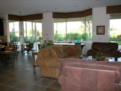 Great room, dinette area, and sunken bar, with sliding glass doors to patio