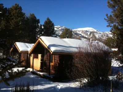 Cabin in winter. Top of Tetons ski area in background
