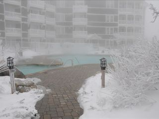 Ahhhh - The Hot Tub & Heated Pool - Snowshoe Mountain condo vacation rental photo