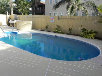 South Padre Island townhome rental - Swimming pool area with BBQ pit area