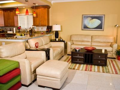 All leather living room sofa, loveseat, big chair ottoman, floor pillows.