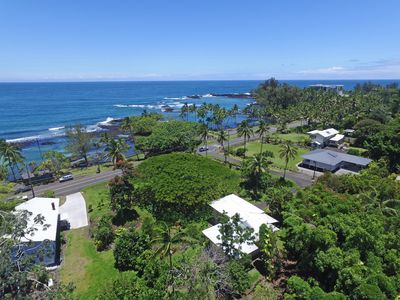The middle house overlooking and just steps away from beach park on Hilo bay.