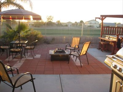 Avondale house rental - Back yard with large patio, fire pit, hot tub and gas barbeque