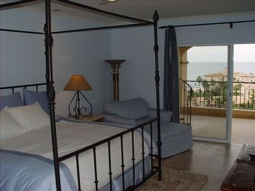 First master suite w/ king bed, private bathroom, opens to terrace, ocean view