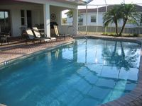 Exclusive villa with pool directly on water and golf / condo