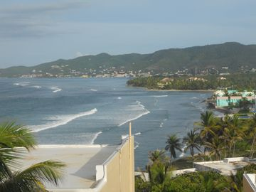 St. Croix condo rental - view to ocean, shore, rolling hills and downtown Christiansted