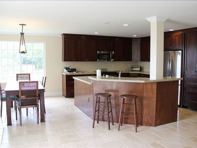 Kitchen and Dining Area With All New Appliances