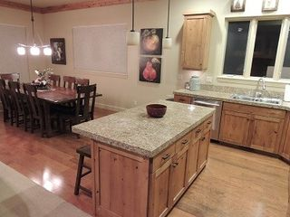 Eden house photo - Stocked kitchen with granite counters. Dining table seats 8, island seats 3.